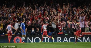 Party time: The Atletico Madrid fans celebrate as their team sets up a final with city-rivals Real Madrid | Chelsea 1-3 Atletico Madrid (1-3 agg)