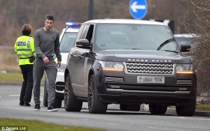 A Female Police Stops Robin van Persie As He Makes Way To Manchester United's Training Ground