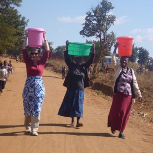 Wife Of World's Richest Man Carries 20 Liters Of Water On Her Head In Malawi