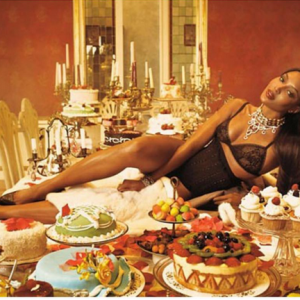 Naomi Campbell Marks Thanksgiving By Striking  Pose On Dinner Table