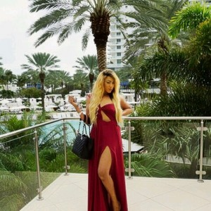Rukky Sanda Stuns In Red Thigh High Slit Dress
