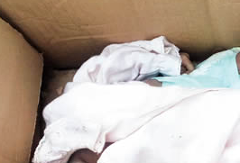 Graphic Photo : People Watch Abandoned Baby Cry To Death In Uyo Over Fear Of Police