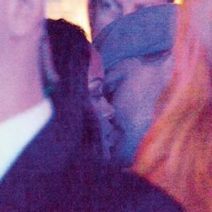 A Photo Of Leonardo and Rihanna kissing Surfaces Online