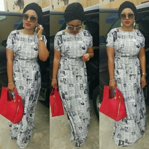 Photos : Mercy Aigbe Steps Out In Stunning Newspaper Print Dress