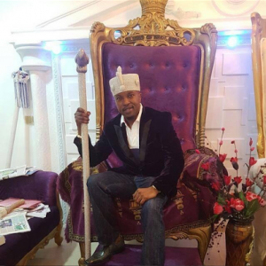 Osun State Monarch Criticized For Wearing A Suit On The Throne (Photo)