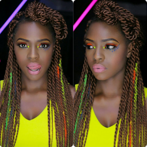 Beverly Osu Shows Off Tongue Piercing In Colourful Photos