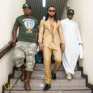 Photos: Singer Flavour Steps Out In Suit Without A Shirt