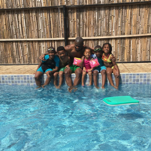 Peter Okoye Goes Swimming With His Kids And Their Friends