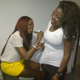 Photo Of Tiwa Savage Signing Autograph On A Fan's Boobs