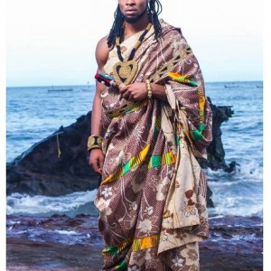 Flavour Pictured Wearing A King's Regalia, Surrounded By Maidens