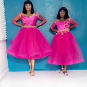 Toyin Lawani & Daughter Rock Matching Pink Outfits & Hair
