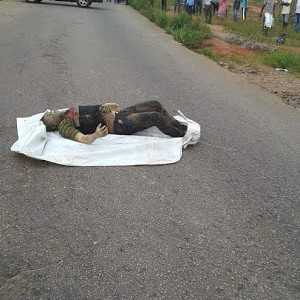 Angry Youths Block Road With A Dead Body In Delta State (Graphic Photos)