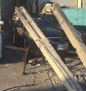 Photos: Electric Pole Falls & Smashes A Car In Lekki, Lagos