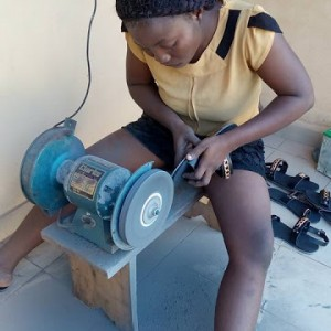 Meet Omotola, Nigerian female graduate turned shoemaker (photos)