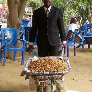 Tiger Nuts seller rocking a suit and tie spotted in Abuja(Photos)