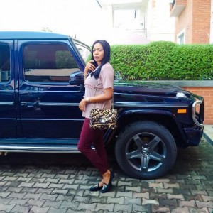 Chika Ike strikes a pose with her G-Wagon