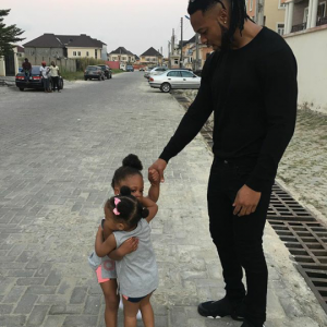 Flavour shares sweet photo of his daughters locked in tight embrace