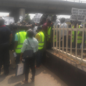 Sacked Dangote workers embark on a protest in Lagos