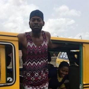 Hilarious: Popular Singer, Adekunle Gold Caught on Camera Working as Bus Conductor in Lagos (Video)