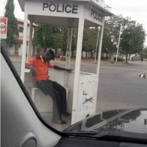 Traffic Warden Caught Sleeping on Duty in Public in Abuja (Photos)