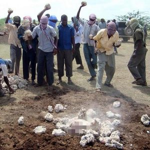 Horror: 44-year-old Man Publicly Stoned to Death for Cheating on His 2 Wives (Photo)