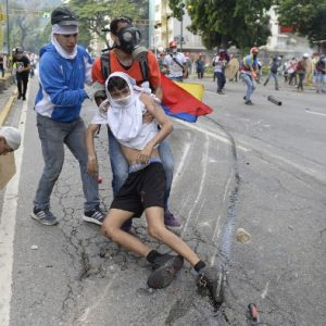 Commotion as Armoured Police Vehicle Crushes Protesters in Venezuela (Graphic Photos)