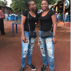 The Aneke twins slay in matching ripped jeans