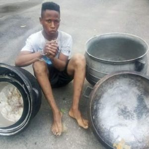 Suspected Pot Thief Apprehended and Paraded with His Loot in Delta State (Photos)