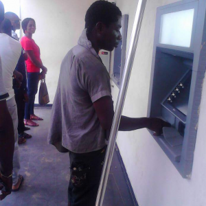 Mentally challenged man spotted trying to withdraw money from ATM without debit card