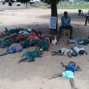 Viral photo of primary school children sleeping under tree in Kwara state