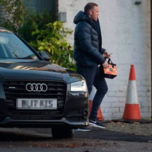 See photos of Wayne Rooney working at garden centre as punishment for drink-driving