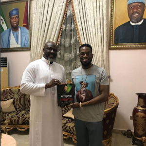 Photo: Dino Melaye presents his new book on corruption to Dbanj in Abuja
