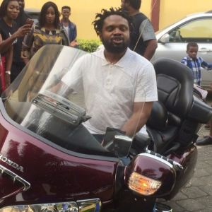 Video : Cobhams Asuquo Rides A Bike