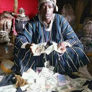 Ogun Native Doctor Poses With Dollars, Claims He Can Make Anyone Rich