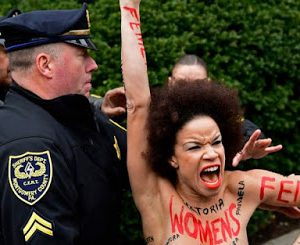 Actress Protests Topless At Bill Cosby's Sexual Assault Retrial