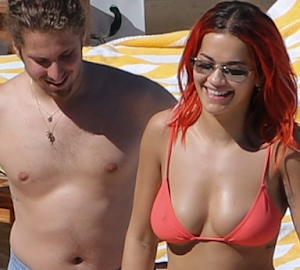 Unclad Photos: Rita Ora Caught Topless By Camera Man At The Beach