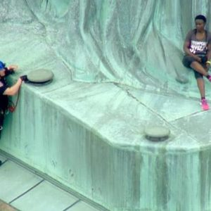 Woman Climbs Statue Of Liberty To Protest Migrant Family Separations