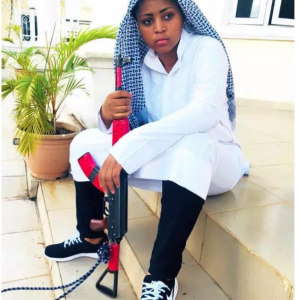 PHOTOS: Actress Regina Daniels Slays In Arab Dress Pictured With An AK-47