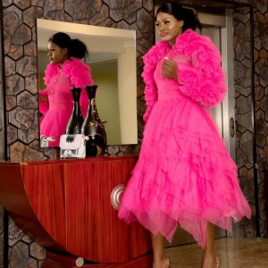 Reality Star, Alex Steps Out In Breath-Taking Pink Dress For A Fundraising Dinner