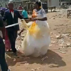 See Video: First Wife Storms Wedding Venue And Pours Red Oil On Her Husband's New Bride's Wedding Gown
