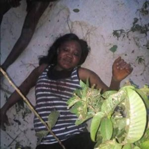 Photos: Woman Caught Allegedly Trying to Behead Her Daughter In Delta State